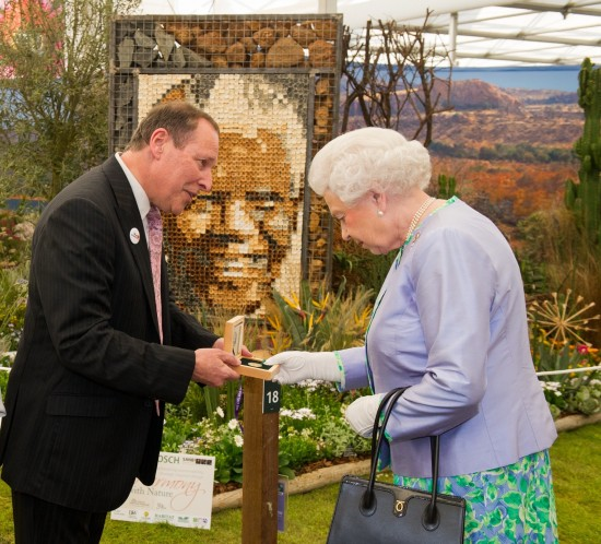 Copyright image 2014©. HM The Queen (R ), meets Lihle Diamini (L) South African National Biodiversity Instltute and Alan Demby, (C) Executive Chairman, The South African Gold Coin Exchange. Her Majesty was given a gold Nelson Mandela medallion, the proceeds of the sale goes to the Nobel Laururete Program and the Mandela Foundation. For further info please contact David Stoch +4420 8563 0182. For photographic enquiries please call Anthony Upton 07973 830 517 or email info@anthonyupton.com This image is copyright Anthony Upton 2014©. This image has been supplied by Anthony Upton and must be credited Anthony Upton. The author is asserting his full Moral rights in relation to the publication of this image. All rights reserved. Rights for onward transmission of any image or file is not granted or implied. Changing or deleting Copyright information is illegal as specified in the Copyright, Design and Patents Act 1988.